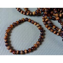 Bracelet Oeil de tigre Q Extra en perles de 6mm .