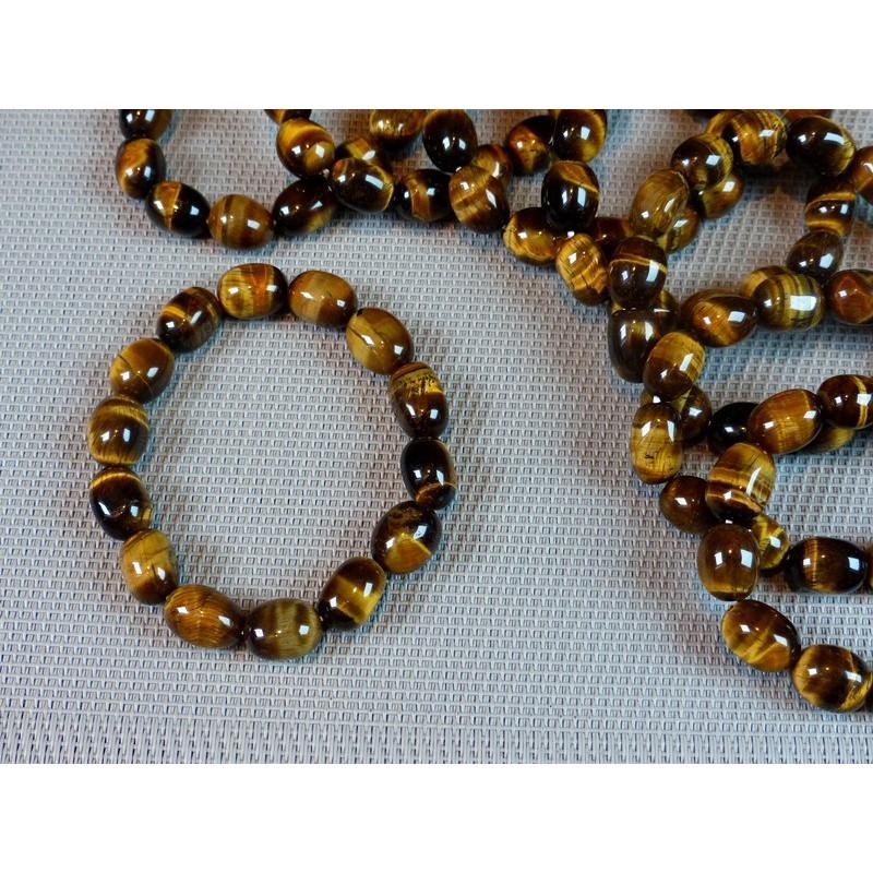 Bracelet Oeil de Tigre Q Extra en pierres roulées XL .