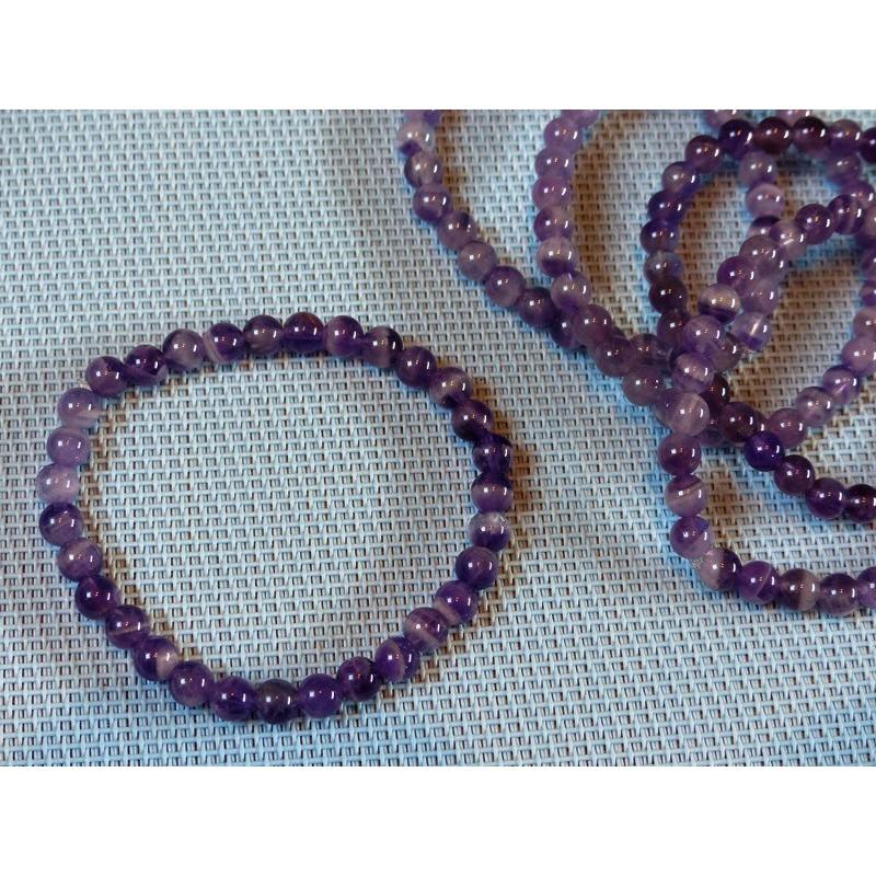 Bracelet Améthyste Q Extra perles de 6mm